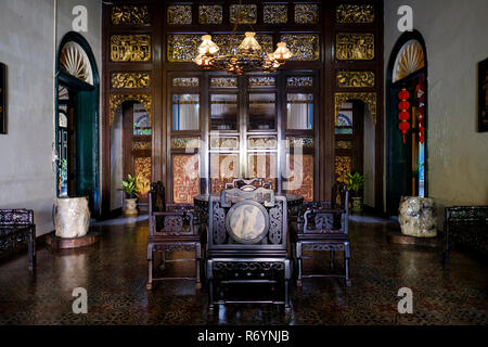 Main hall with carved wood panel at the back, Tjong A Fie Mansion, Medan, North Sumatra, Sumatra, Indonesia. - Stock Image
