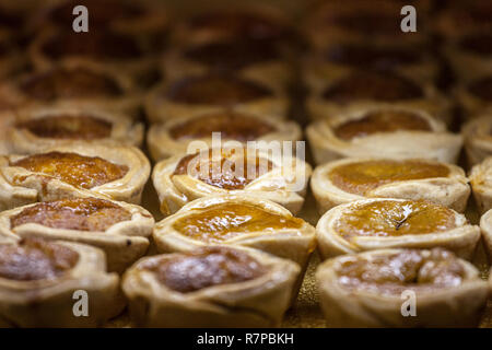 Butter tarts, small size, for sale on the shelf of a Canadian Market of Toronto. Butter tart is considered to be one of the most iconic pastries of th - Stock Image