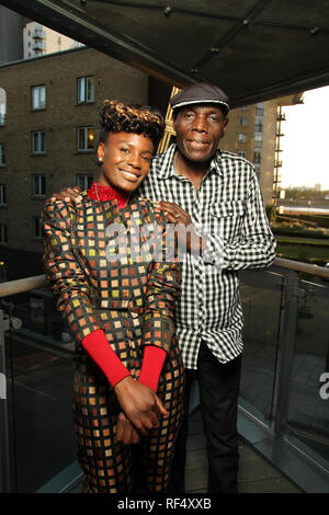 London, UK - 15 August 2012: Afro-jazz musician Oliver Mtukudzi with Shingai Shoniwa of the Noisettes pose for photos ahead of a concert at the O2 in London. The legendary musician from Zimbabwe, whose lyrics often carried social messages about HIV/Aids and coded political commentary.Photo: David Mbiyu/ Alamy Live News - Stock Image