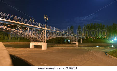 Pedestrian bridge across the river 'Anchor' in Tashkent. This bridge was built in  'The Museum of memory - Stock Image