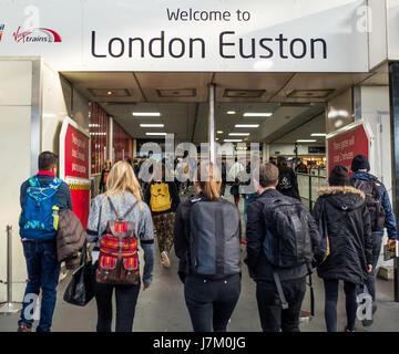 Passengers at London Euston Station UK - Stock Image