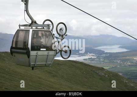 A cable car carrying mountain bikes to the downhill mountain bike course at the Nevis Range near Fort William - Stock Image
