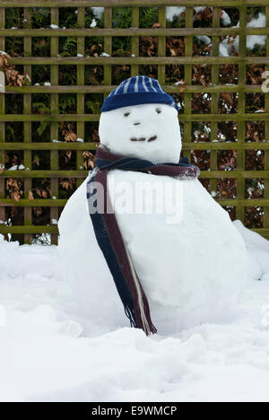 Happy snowman with wooly hat and scarf.. - Stock Image