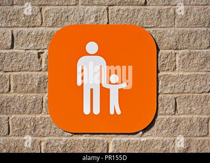 Parent and child car parking logo. Sainsbury's  and Argos Supermarket. Shap Road, Kendal, Cumbria, England, United Kingdom, Europe. - Stock Image