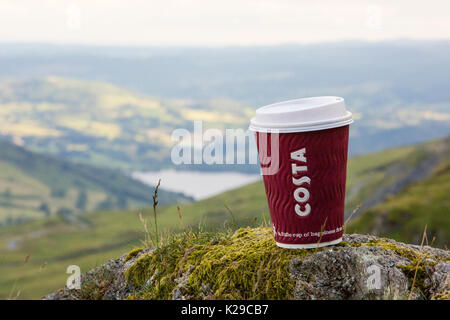A Costa takeaway coffee cup discarded by some brainless idiot, half way up Red Screes in the Lake District, UK. - Stock Image