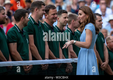 London, UK. 14th July 2019. Wimbledon Tennis Tournament, Day 13, mens singles final; Catherine Duchess of Cambridge speaks with the Wimbledon groundsmen Credit: Action Plus Sports Images/Alamy Live News - Stock Image