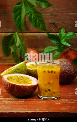 passion fruit juice in glass - Stock Image