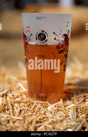 Woodstock, UK, 4th August 2018. Visitors flocked to BBC Countryfile Live, held within the grounds of Blenheim Palace. Animals, wildlife, food, outdoor sports, conservation, farming, rural affairs, entertainment, all were represented. Returnable plastic beer glass, £1 deposit returnable.Credit: Stephen Bell/Alamy Live News. - Stock Image