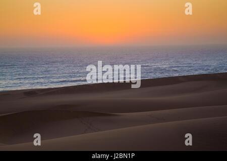 Africa, Namibia, Namib Desert, Swakopmund. Sunset on Skeleton Coast. Credit as: Wendy Kaveney / Jaynes Gallery / - Stock Image