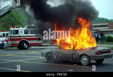 car fully engulfed in flames - Stock Image