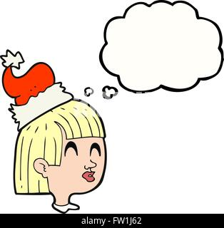 freehand drawn thought bubble cartoon girl wearing christmas hat - Stock Image