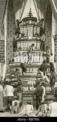 Building the royal catafalque, Cambodia, South East Asia (then a French Protectorate). The structure was built on the death of King Norodom in 1904, and has his funerary urn at the top. - Stock Image