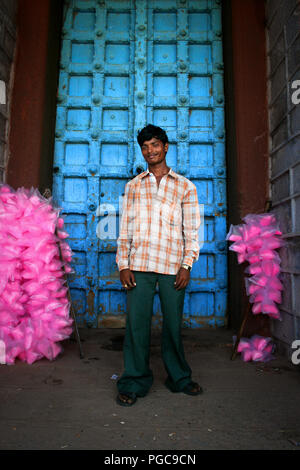 A man stands in front of the door of a temple in Kanyakumari, India - Stock Image
