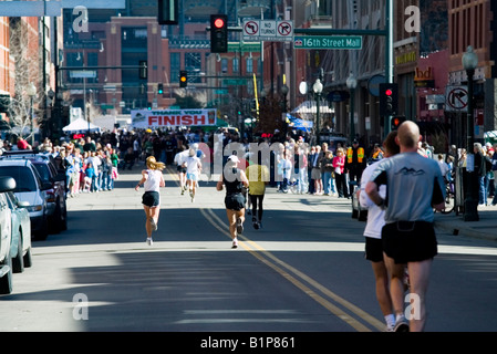 Running to the Finish Line at the Running of the Green footrace held in the LoDo area of downtown Denver - Stock Image