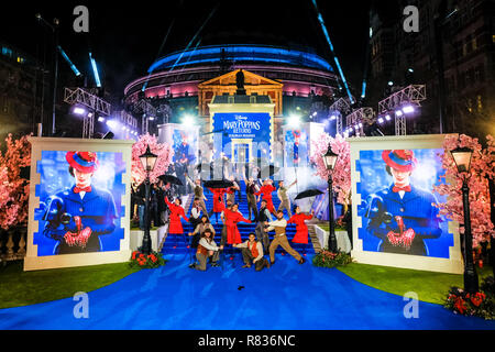 London, UK. 12th December, 2018. Dancers perform on the blue carpet at the European Premier of Mary Poppins Returns on Wednesday 12 December 2018 held at The Royal Albert Hall, London. Pictured: A general view of the blue carpet leading up to the Royal Albert Hall. Credit: Julie Edwards/Alamy Live News - Stock Image