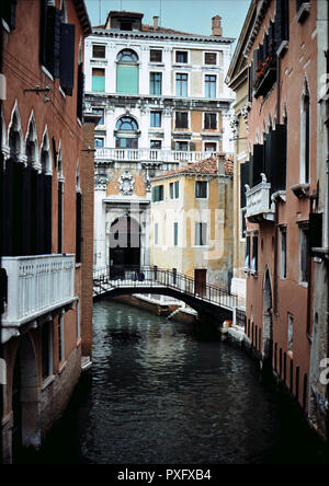 Venetian Palace by a canal in Venice showing the grandeur and decay of the city, Italy - Stock Image