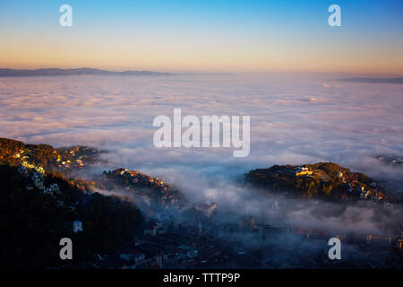 Aerial view of cloudscape over city against sky - Stock Image