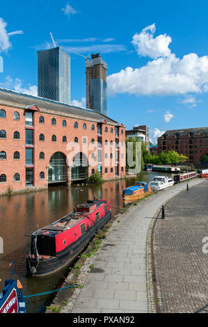 The Merchants Warehouse with the Deansgate Square apartment blocks behind.  From the Bridgewater Canal at Castlefield Basin, Manchester, England, UK. - Stock Image