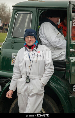 A race marshall waits in the cold at the annual Goodwood Members Meeting in West Sussex - Stock Image