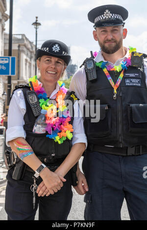London, UK. 7th July 2018.  Pride in London Parade 2018 Two met police officers get in the the spirit of Pride in London Credit Ian Davidson/Alamy Live News - Stock Image