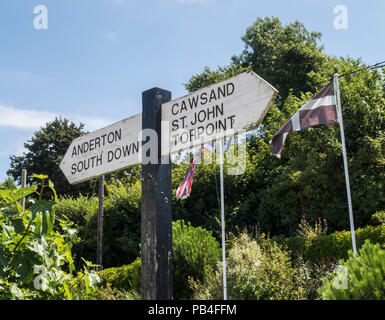 Cornish flag and signpost to Torpoint,Anderton,South Down,Cawsand, and St John at Millbrook, Cornwall - Stock Image
