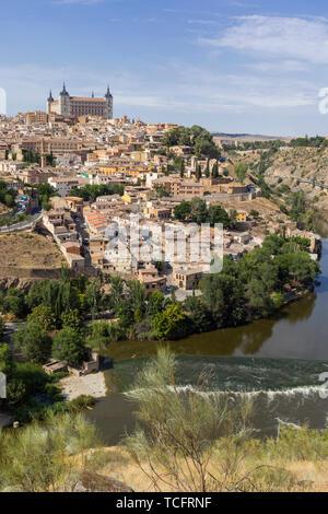 Toledo, Toledo Province, Castilla-La Mancha Spain.  Overall view of the historic centre showing the Tagus River (Rio Tajo) and the Alcazar.  Toledo is - Stock Image