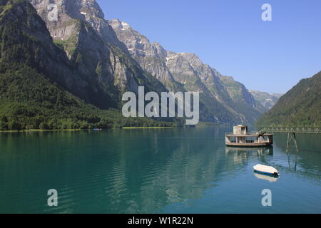 Mountains of the Glaernisch range and clear water of Lake Kloental, Switzerland. - Stock Image