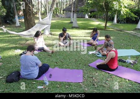 Group practicing Pranayama at a yoga retreat in kerala India - Stock Image