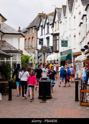 Visitors and tourists browse the shops in Lynmouth street, Lynmouth,Devon,UK - Stock Image