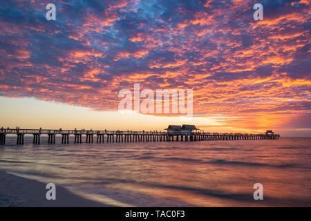Colorful Alto-Sunset over the pier, Naples, Florida, USA - Stock Image