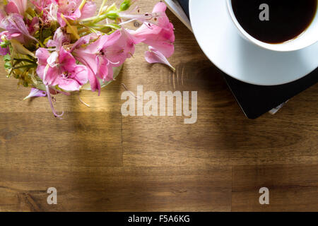 Reading and drinking coffee on a relaxing afternoon. - Stock Image
