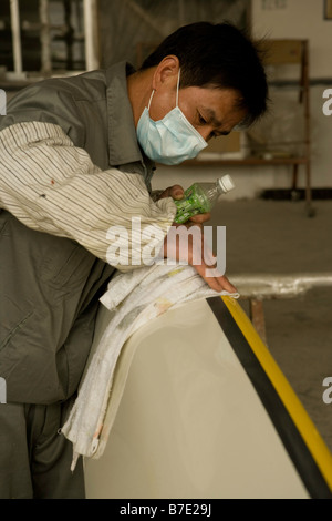 worker making kayaks shanghai china - Stock Image
