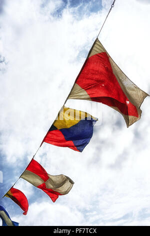 Marine flags on a rope on the sky background - Stock Image