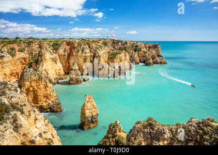 Algarve coast Portugal Ponta da Piedade coastal rock formations with caves and grottos visited by boat tours from Lagos Algarve Portugal EU Europe - Stock Image