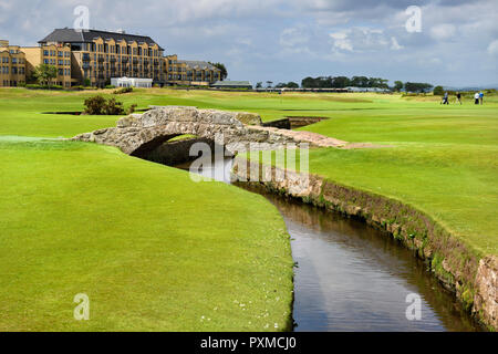 Swilken Bridge over Swilcan Burn on the 18th Hole of the Old Course at St Andrews Links golf course the oldest in the world in St Andrews Scotland UK - Stock Image