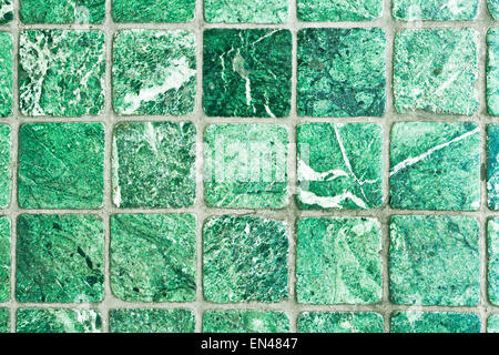 Green stone floor tiles as a background - Stock Image