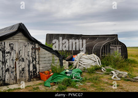 Thick heavy rope stored at overturned boat sheds on Holy Island of Lindisfarne Berwick-upon-Tweed England UK - Stock Image