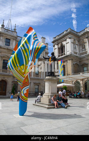 colourful fibreglass sculpture by Yinka Shonibare of Nigeria stands in front of the statue of Sir Joshua Reynolds - Stock Image