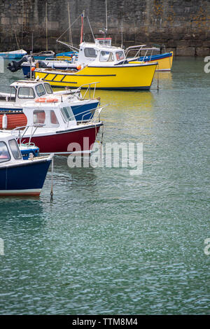 Boats in the harbour at Porthleven in Cornwall, England - Stock Image