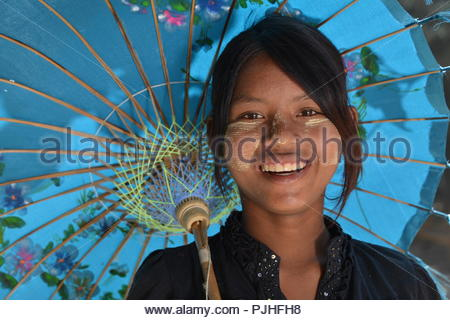 Myanmar, young woman with her umbrella to protect herself from the sun near the Mingun Pagoda - Stock Image