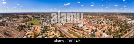 Lightning Ridge opal mining town in australian outback arid dry climate - centre of country opal industry. Elevated aerial panoramic view over town st - Stock Image