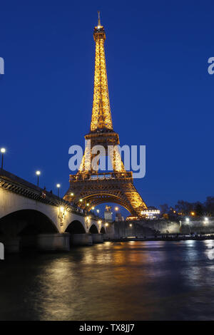 PARIS, FRANCE - February 25 , 2019 : Eiffel Tower illuminated at night. It's a wrought iron lattice tower named after the engineer Gustave Eiffel loca - Stock Image