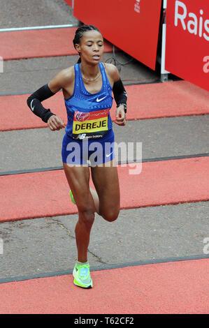 London, UK, 28 April 2019 Roza Dereje of Ethiopia. Runners at finishing line of  Virgin London Marathon Credit: JOHNNY ARMSTEAD/Alamy Live News - Stock Image