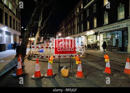 Road Closed sign and traffic cones in road, London, England, UK - Stock Image