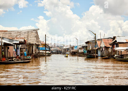 Wooden houses on sticks in flooded area of Belem, Iquitos, Peru. The district is poor and populated by indigenous people who moved to the city. - Stock Image