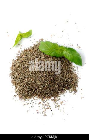 Fresh organic basil and ground basil isolated on white background. - Stock Image