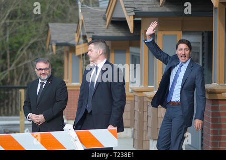 Canadian Prime Minister Justin Trudeau (waving) and Dan Ruimy, Ridge/Meadows MP representative in the House of Commons (left). Security in center. - Stock Image