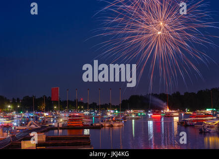 Fireworks of summer holiday in a city. - Stock Image