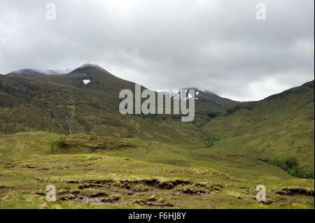 Looking up from Glen Nevis to the lower slopes of the main Nevis Range shrouded in mist and low cloud - Stock Image