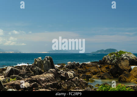 rocks and geological formation along rugged coastline in Florianopolis, Brazil - Stock Image